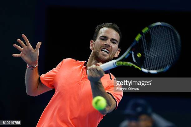 Adrian Mannarino of France returns a shot against Rafael Naldal of Spain during the Men's singles third round match on day six of the 2016 China Open...