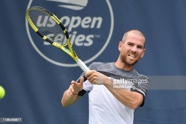 Adrian Mannarino of France returns a shot from during a match against Norbert Gombos of Slovakia during Day 3 of the Citi Open at Rock Creek Tennis...