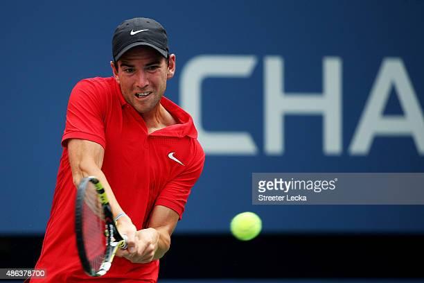 Adrian Mannarino of France returns a shot to Andy Murray of Great Britain during their Men's Singles Second Round match on Day Four of the 2015 US...