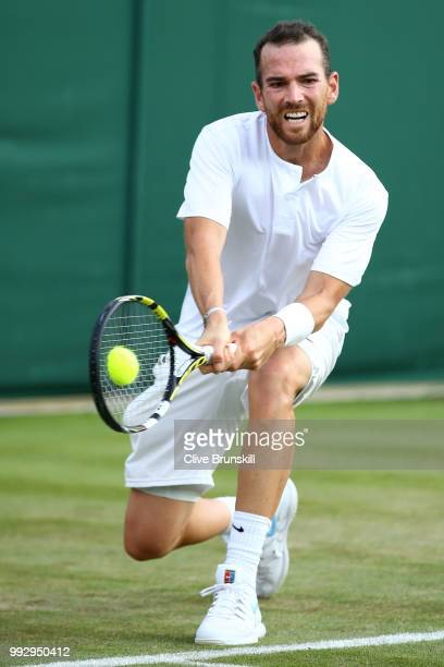 Adrian Mannarino of France returns against Daniil Medvedev of Russia during their Men's Singles third round match on day five of the Wimbledon Lawn...