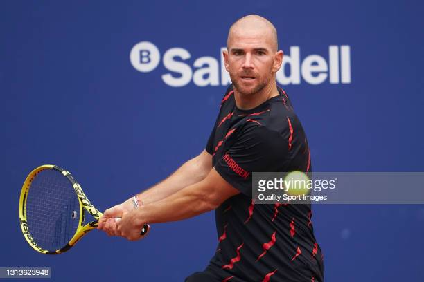 Adrian Mannarino of France returns the ball during his Men's Singles round of 32 match against Albert Ramos-Vinolas of Spain on day three of the...