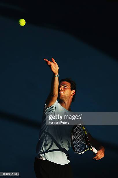 Adrian Mannarino of France serves against Jack Sock of the USA during day one of the Heineken Open at ASB Tennis Centre on January 6 2014 in Auckland...