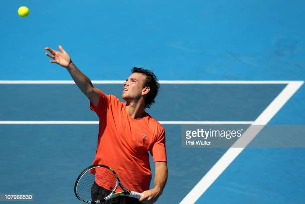 Adrian Mannarino of France serves during his game against Juan Monaco of Argentina on day two of the Heineken Open at ASB Tennis Centre on January 11...