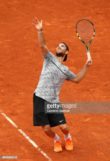 Adrian Mannarino of France serves during his mens singles first round match against Steve Johnson of The United States during day three of the 2018...