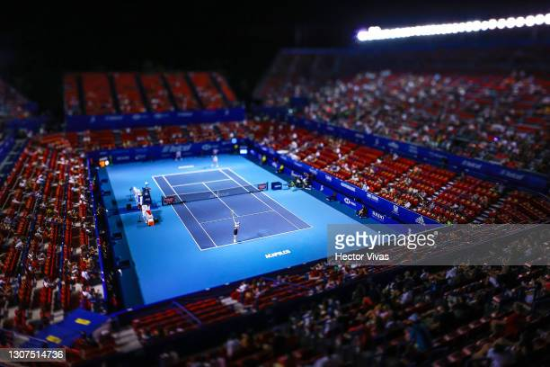Adrian Mannarino of France serves during the match against Grigor Dimitrov of Bulgaria as part of the Telcel Mexican Open 2021 at Princess Mundo...