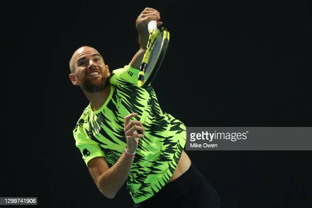 Adrian Mannarino of France serves in his match against Mikael Ymer of Sweden during day one of the ATP 250 Murray River Open at Melbourne Park on...