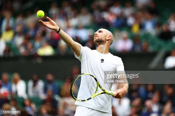Adrian Mannarino of France serves in his Men's Singles First Round match against Roger Federer of Switzerland during Day Two of The Championships -...