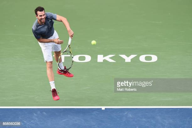 Adrian Mannarino of France serves in his semi final match against Marin Cilic of Coratia during day six of the Rakuten Open at Ariake Coliseum on...