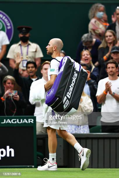 Adrian Mannarino of France walks off the court after retiring from the match with an injury in his Men's Singles First Round match against Roger...