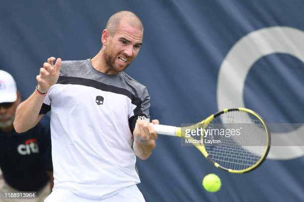 Adrian Mannarino of the France returns a shot from Norbert Gombos of the Slovakia during Day 3 of the Citi Open at Rock Creek Tennis Center on July...
