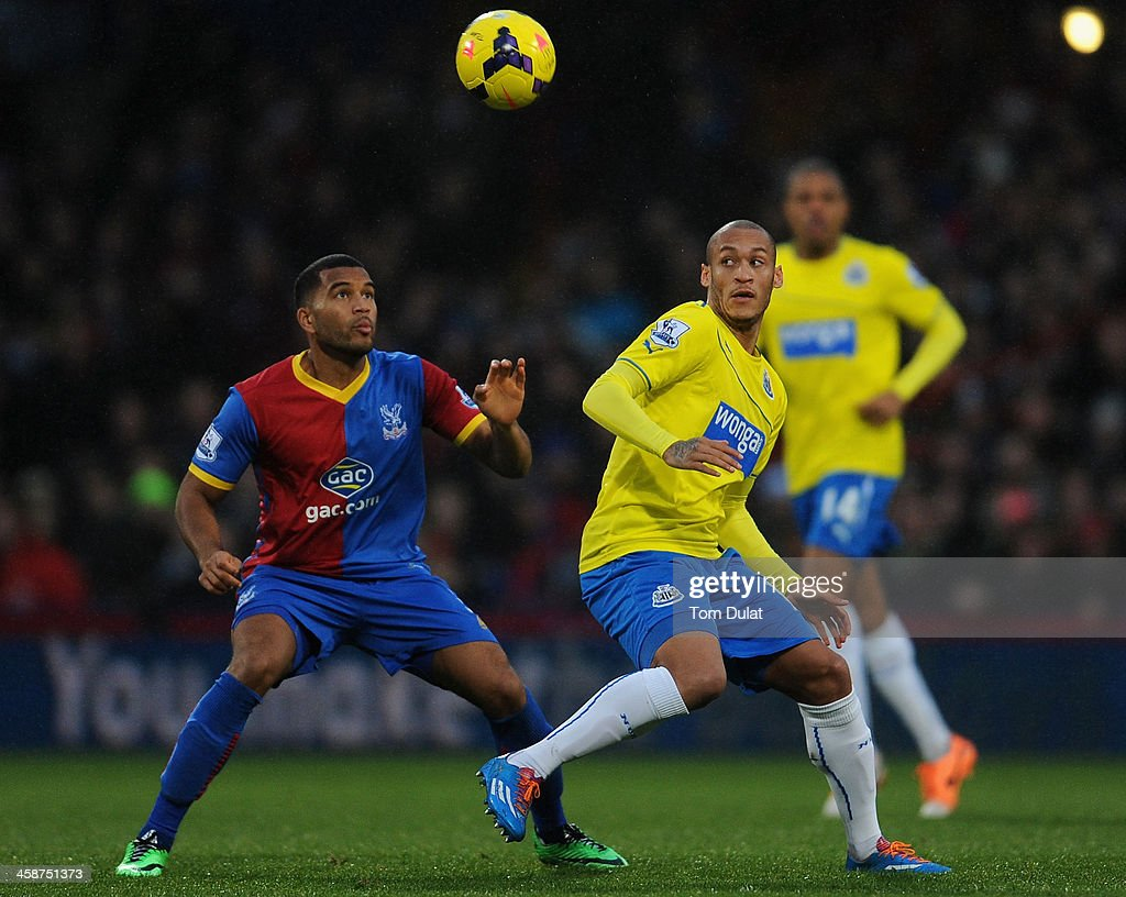 Adrian Mariappa of Crystal Palace and Yoan Gouffran (R) of Newcastle United compete for the ball during the Barclays Premier League match between Crystal Palace and Newcastle United at Selhurst Park on December 21, 2013 in London, England.