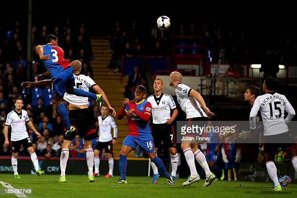 Adrian Mariappa of Crystal Palace rises above the Fulham defence to score the opening goal during the Barclays Premier League match between Crystal...