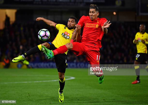 Adrian Mariappa of Watford and Roberto Firmino of Liverpool compete for the ball during the Premier League match between Watford and Liverpool at...