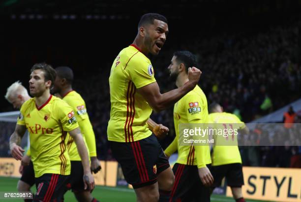Adrian Mariappa of Watford celebrates as Will Hughes of Watford scores their first goal during the Premier League match between Watford and West Ham...