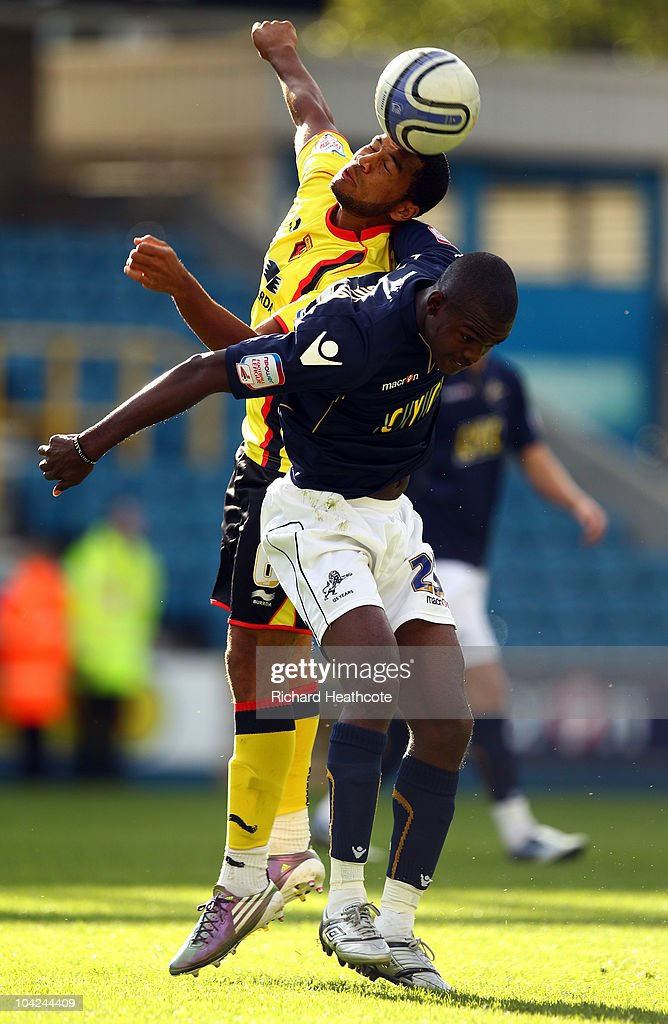 Adrian Mariappa of Watford challenges Theo Robinson of Millwall during the npower Championship match between Millwall and Watford at The Den on September 18, 2010 in London, England.
