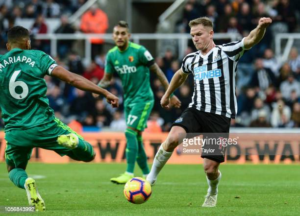 Adrian Mariappa of Watford FC slides in to intercept the ball from Matt Ritchie of Newcastle United during the Premier League match between Newcastle...