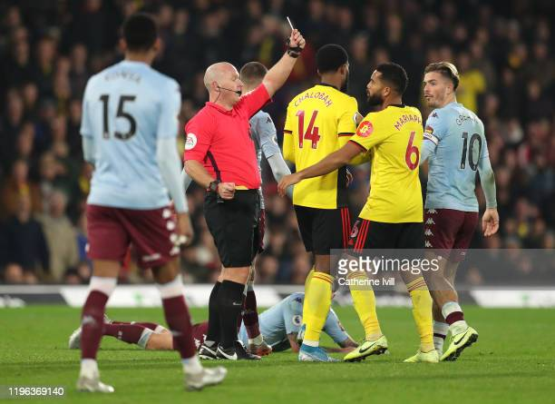 Adrian Mariappa of Watford is shown a red card by referee Simon Hooper during the Premier League match between Watford FC and Aston Villa at Vicarage...
