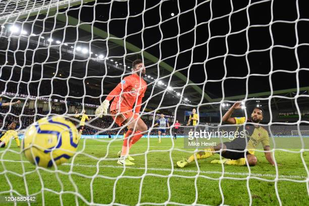Adrian Mariappa of Watford scores an own goal during the Premier League match between Brighton & Hove Albion and Watford FC at American Express...