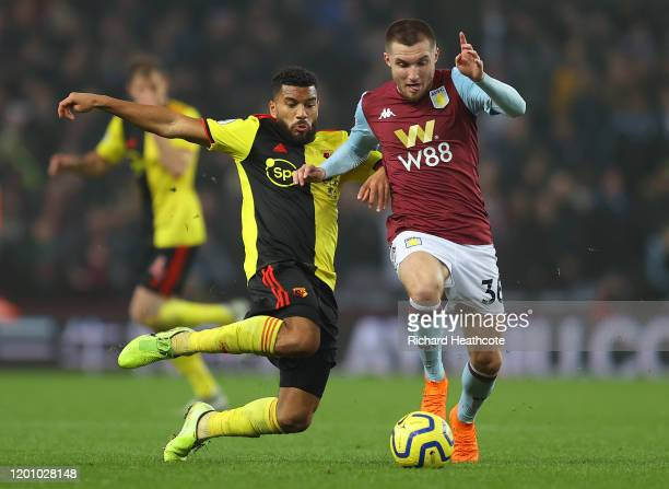 Adrian Mariappa of Watford tackles Indiana Vassilev of Aston Villa during the Premier League match between Aston Villa and Watford FC at Villa Park...