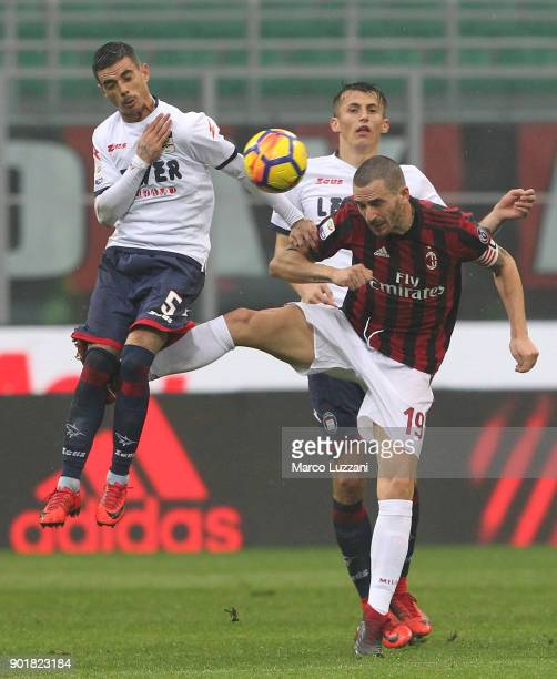 Adrian Marius Stoian of FC Crotone competes for the ball with Leonardo Bonucci of AC Milan during the serie A match between AC Milan and FC Crotone...