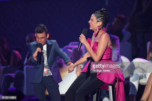 Adrian Martin an Natalia Jimenez present an award during Univision's 'Premios Juventud' 2017 Celebrates The Hottest Musical Artists And Young Latinos...