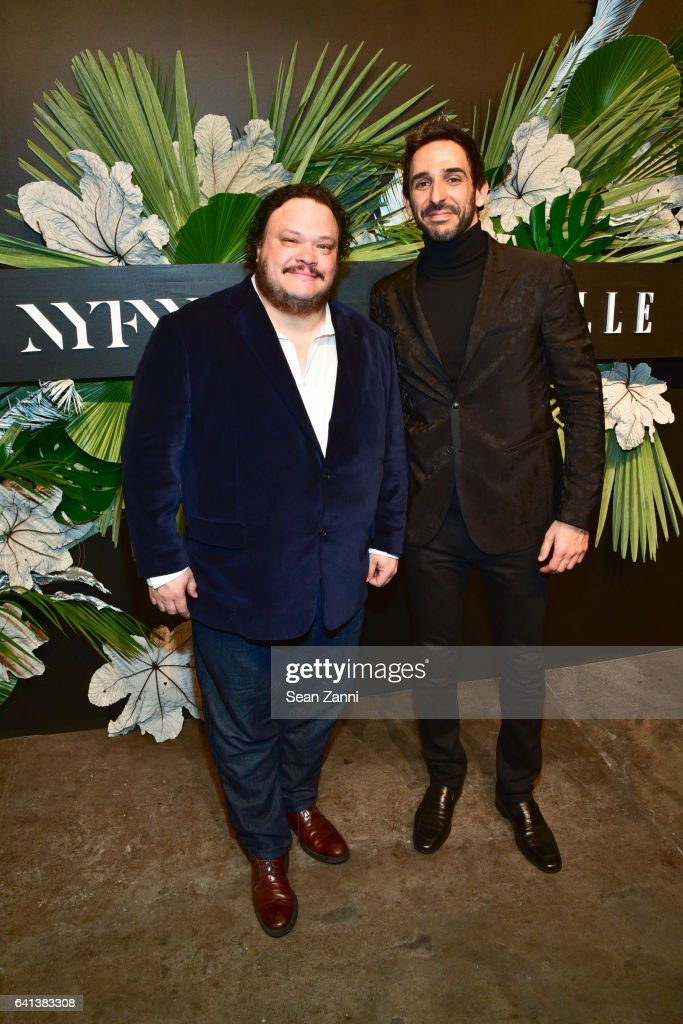 Adrian Martinez and Amir Arison at ELLE, E! And IMG Host New York Fashion Week February 2017 Kick-Off Event at 40 Bethune Street on February 8, 2017 in New York City.