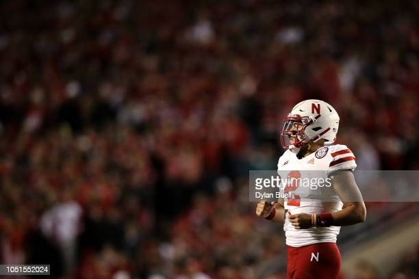 Adrian Martinez of the Nebraska Cornhuskers jogs onto the field in the third quarter against the Wisconsin Badgers at Camp Randall Stadium on October...