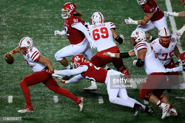 Adrian Martinez of the Nebraska Cornhuskers rushes for yards against Elorm Lumor of the Rutgers Scarlet Knights during the second quarter at SHI...