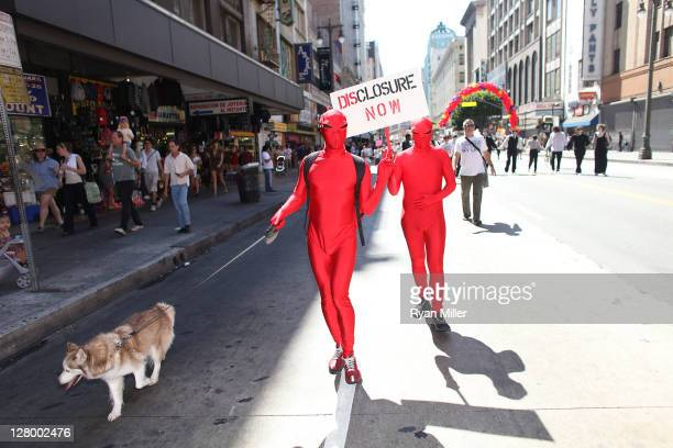 Adrian Massey , Samuel Cormier walk during the Trespass Parade through downtown Los Angeles and ending at the Museum of Contemporary Art to celebrate...