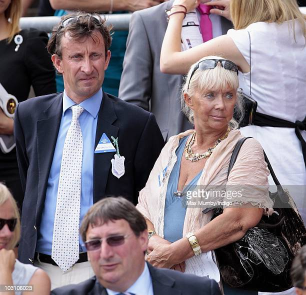 Adrian McGlynn and Sarah Kennedy attend the 'Betfair Weekend' horse racing meet at Ascot racecourse on July 24 2010 in Ascot England