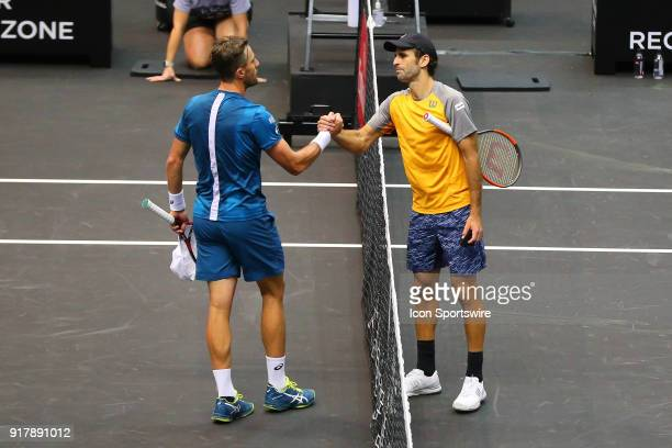 Adrian Menendez Maceiras of Spain shakes hands with Steve Johnson of the United States after winning the match of the New York Open Tennis on...