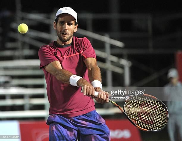 Adrian Menendez-Maceiras of Spain plays a backhand during a match between Adrian Menendez-Maceiras of Spain and Bernard Tomic of Australia as part of...