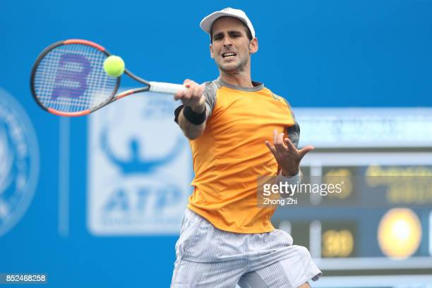 Adrian Menendez-Maceiras of Spain returns a shot during the match against Rigele Te of China during Qualifying first round of 2017 ATP Chengdu Open...