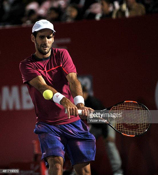 Adrian Menendez-Maceiras of Spain takes a backhand during a match between Adrian Menendez-Maceiras of Spain and Bernard Tomic of Australia as part of...