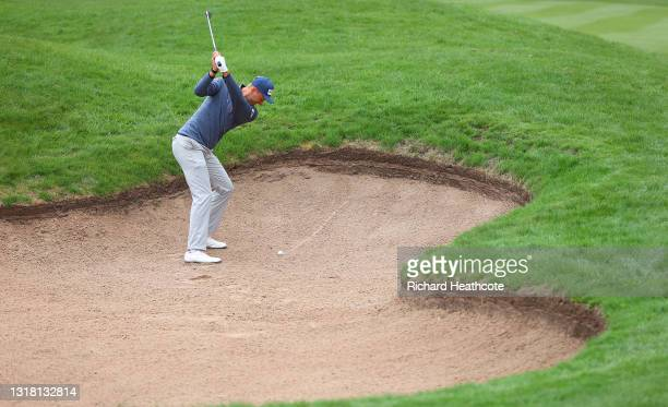 Adrian Meronk of Poland plays his second shot from a fairway bunker on the third hole during the final round of The Betfred British Masters hosted by...