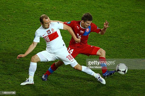 Adrian Mierzejewski of Poland and Vaclav Pilar of Czech Republic fight for the ball during the UEFA EURO 2012 group A match between Czech Republic...