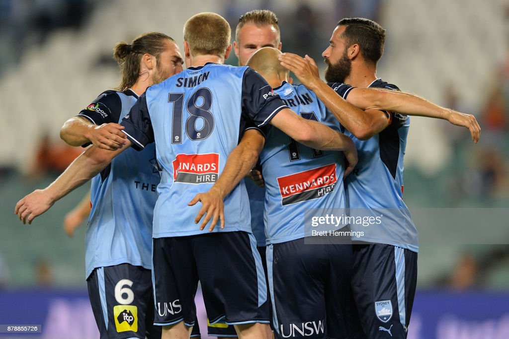 Adrian Mierzejewski of Sydney celebrates scoring a goal with team mates during the round eight A-League match between Sydney FC and the Brisbane Roar at Allianz Stadium on November 25, 2017 in Sydney, Australia.