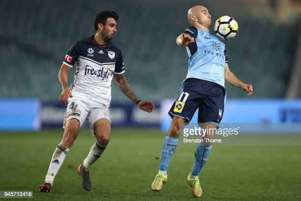 Adrian Mierzejewski of Sydney competes with Rhys Williams of the Victory during the round 27 ALeague match between Sydney FC and the Melbourne...