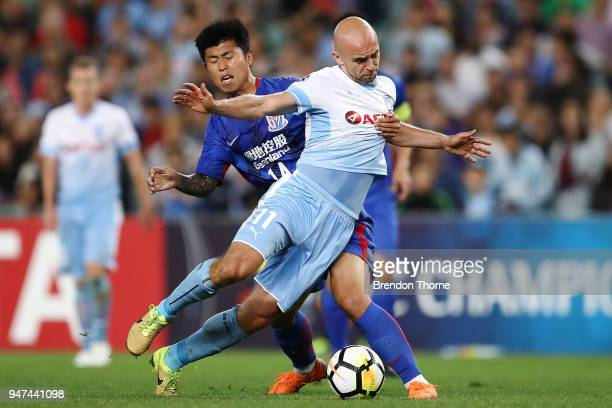Adrian Mierzejewski of Sydney competes with Sun Kai of Shanghai Shenhua FC during the AFC Champions League match between Sydney FC and Shaghai...