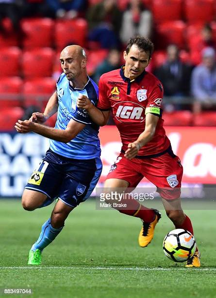 Adrian Mierzejewski of Sydney FC and Isaias of Adelaide United during the round nine ALeague match between the Adelaide 36ers and the Sydney Kings at...
