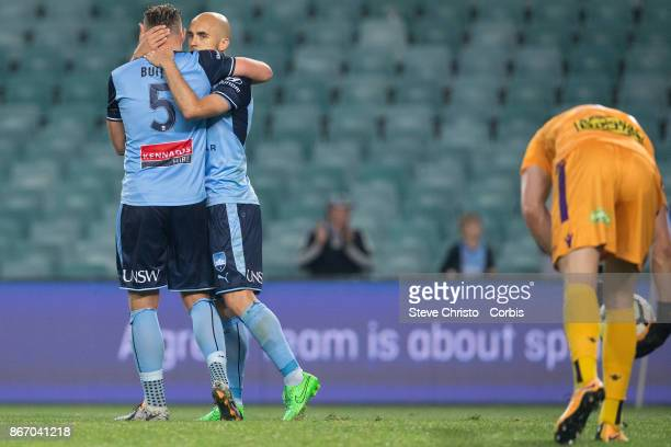 Adrian Mierzejewski of Sydney FC celebrates scoring a penalty with teammate Jordy Buijs during the round four ALeague match between Sydney FC and the...