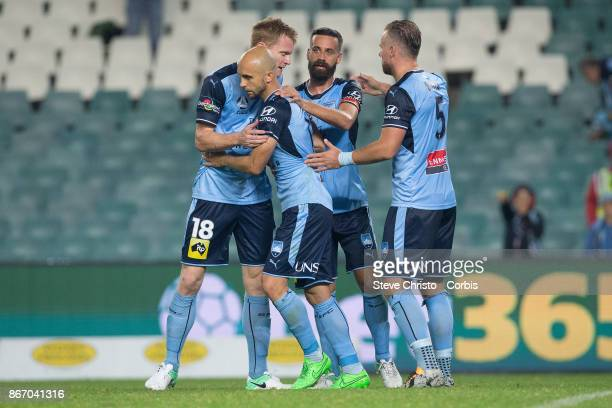 Adrian Mierzejewski of Sydney FC celebrates scoring a penlty with teammates Matthew Simon Alex Brosque and Jordy Buijs during the round four ALeague...
