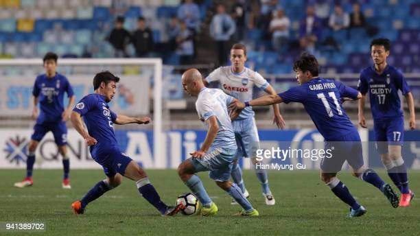 Adrian Mierzejewski of Sydney FC controls the ball under pressure of Suwon Samsung Bluewings defense during the AFC Champions League Group H match...