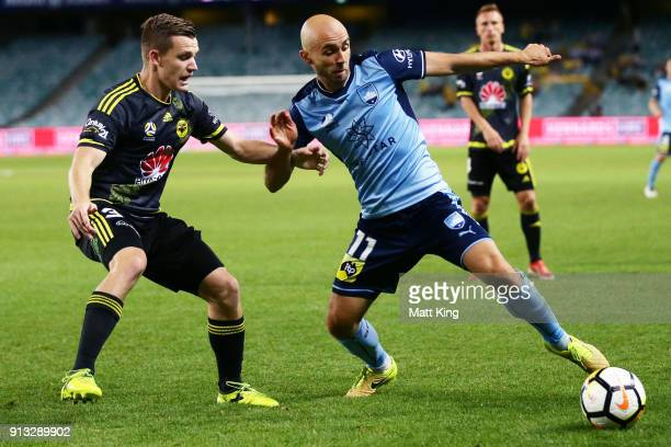 Adrian Mierzejewski of Sydney FC is challenged by Scott Galloway of Wellington Phoenix during the round 19 ALeague match between Sydney FC and the...