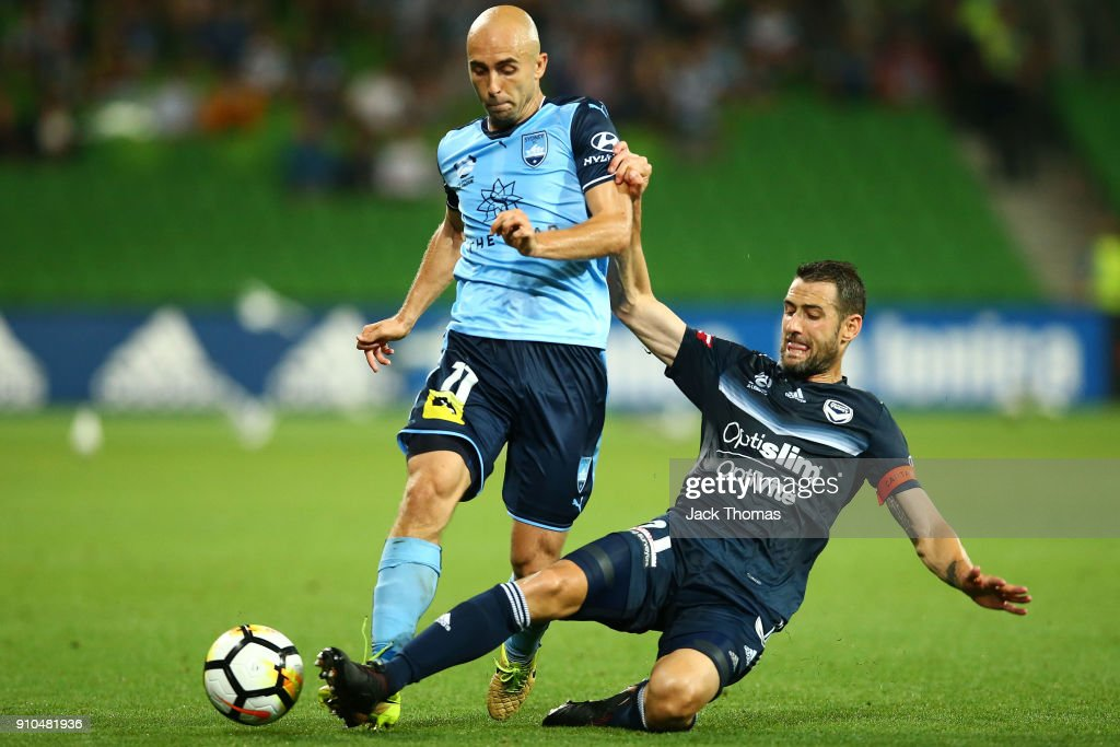 Adrian Mierzejewski of Sydney FC is tackled by Carl Valeri of the Victory during the round 18 A-League match between Melbourne Victory and Sydney FC at AAMI Park on January 26, 2018 in Melbourne, Australia.