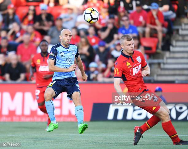 Adrian Mierzejewski of Sydney FC kicks into Jordan Elsey of Adelaide United during the round 16 ALeague match between Adelaide United and Sydney FC...