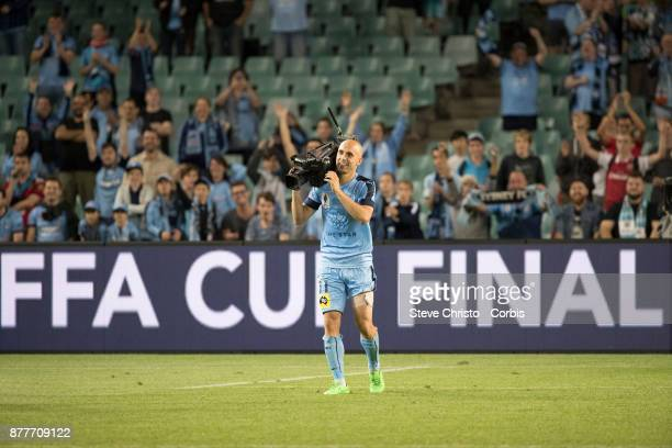 Adrian Mierzejewski of Sydney FC uses a broadcast camera to film his teammates and the cove during the FFA Cup Final match between Sydney FC and...