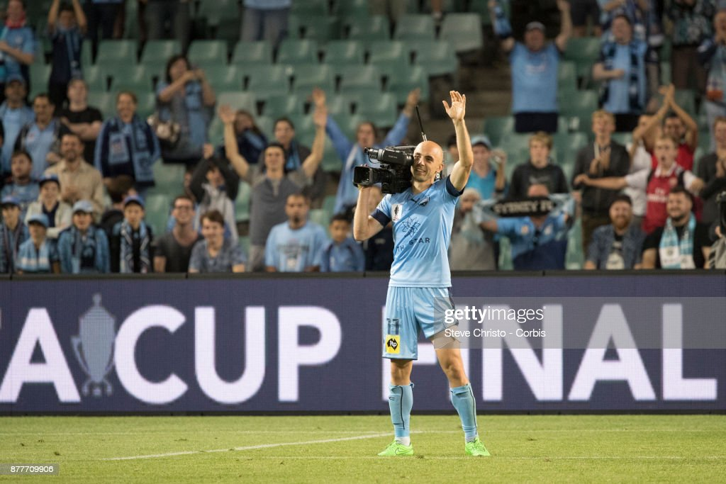 Adrian Mierzejewski of Sydney FC uses a broadcast camera to film his teammates and the cove during the FFA Cup Final match between Sydney FC and Adelaide United at Allianz Stadium on November 21, 2017 in Sydney, Australia.