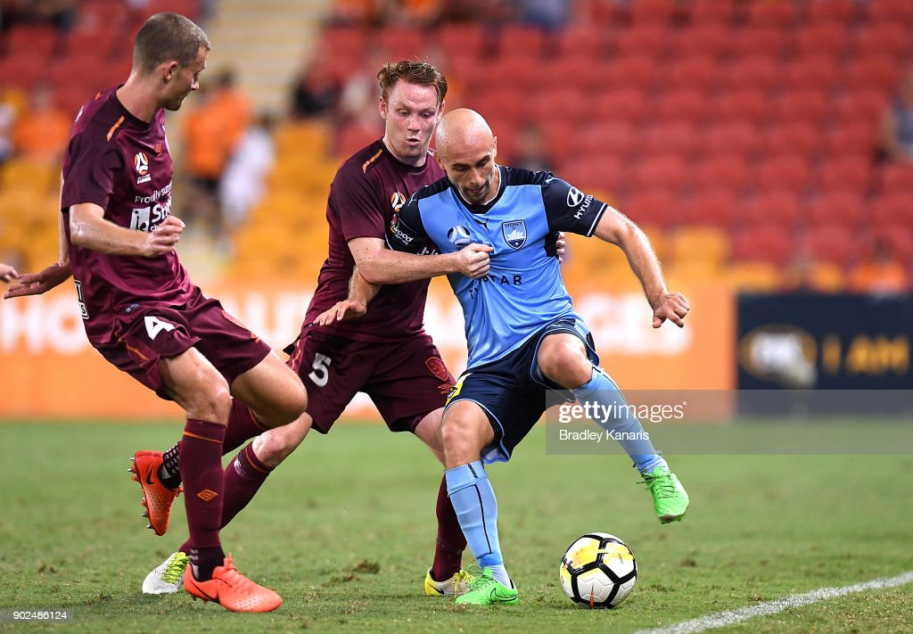 Adrian Mierzejewski of Sydney is pressured by the defence during the round 15 A-League match between the Brisbane Roar and Sydney FC at Suncorp Stadium on January 8, 2018 in Brisbane, Australia.