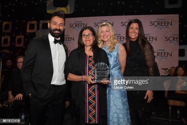 Adrian Molina Composer Germaine Franco winner of the Shirley Walker Award CEO of ASCAP Beth Matthews and Erin Scully pose onstage for a photo at the...